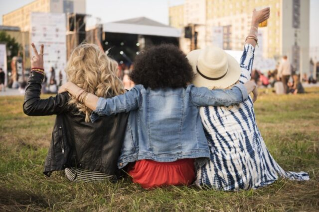 Group of friends watching a concert outdoors