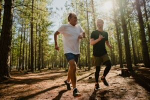 Father and Son Running in a Forest