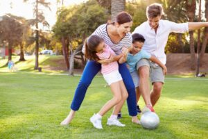 Family playing with a soccer ball