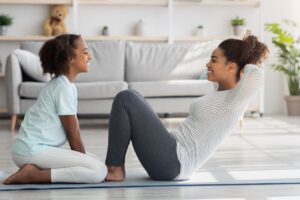 Mother and Daughter doing Situps
