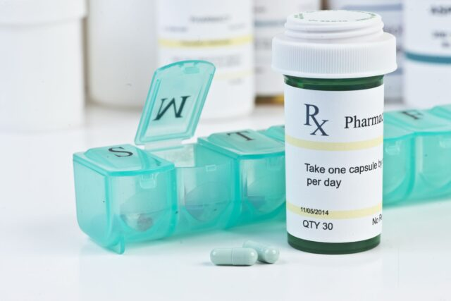 Closeup of Medication Bottle and Pill Container