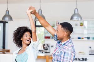 Young couple dancing and smiling