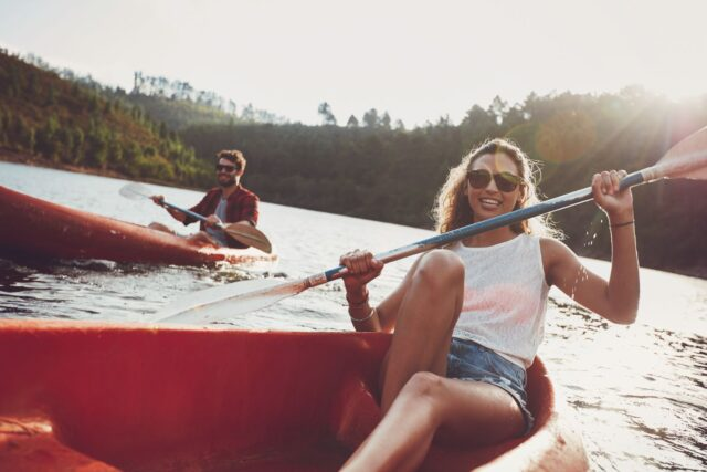Young Couple Kayaking in a Lake