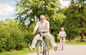 Senior man and woman bicycling