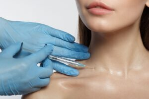 Woman being Injected in base of neck